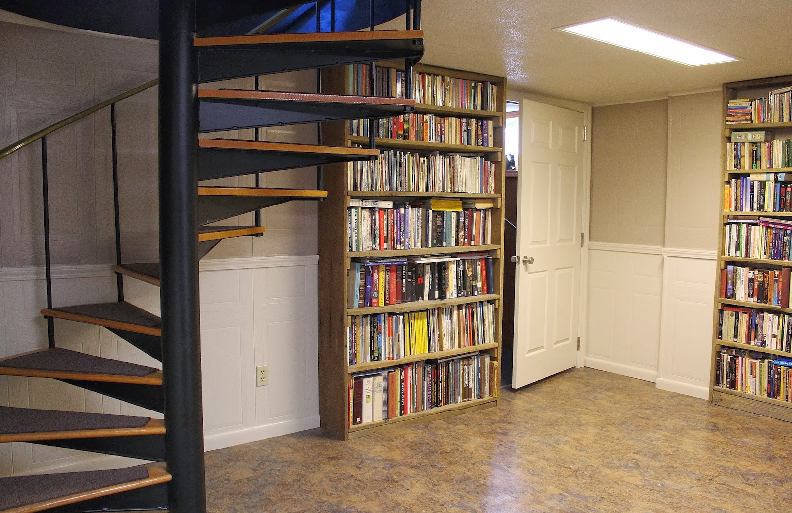 Chair Rail Shelving Part - 24: After Remodel: New Flooring, Chair Rail, Doors, Book Shelves, And Updated  Wrought Iron Stairs.