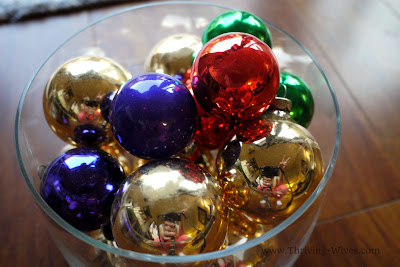 holiday decorating on a budget ornaments in jars and vases