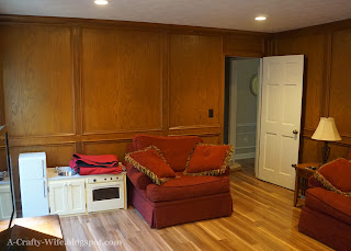 wood judges paneling painting in den | A Crafty Wife