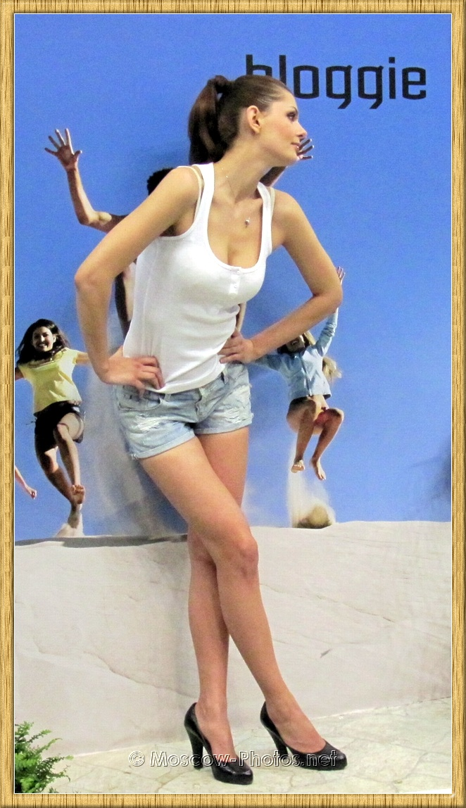 Model posing in vintage denim shorts