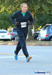 Denny Shortal crossing the finish line in the Run Dunwoody 5K