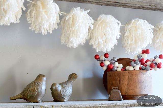 Cozy Winter Decor White Yarn Pom Pom Garland Strung on Rustic Wood Shelves - One Mile Home Style