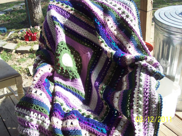 Sampler afghan in purples, blues and greens