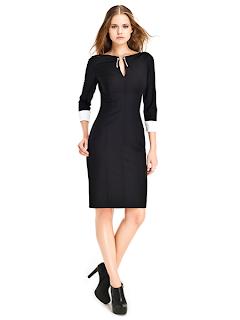 kısa siyah abiye modeli, şık görünüm, dar hatlar, günlük giyim için uygun elbise modeli