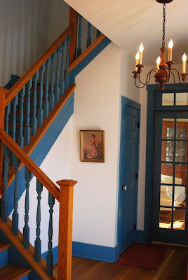 Colonial blue entrance hall and split staircase