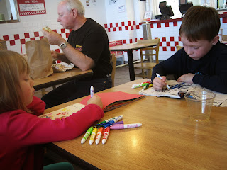 Children colouring at an airport restaurant