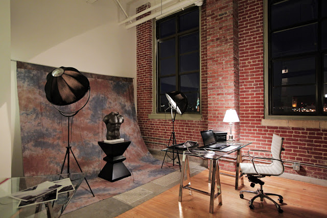 Photo of photographers studio with the desk inside of the penthouse