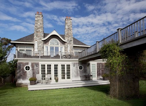 exterior of Hamptons mansion with patio and lawn