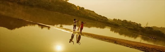 Rohan and Veera dance at the river bathed in golden light.