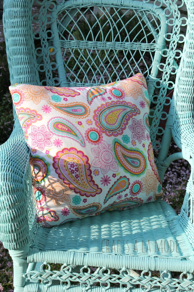 Square pillow in pinks and blues