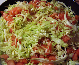 Green Cabbage and Red Tomatoes in Electric Frying Pan
