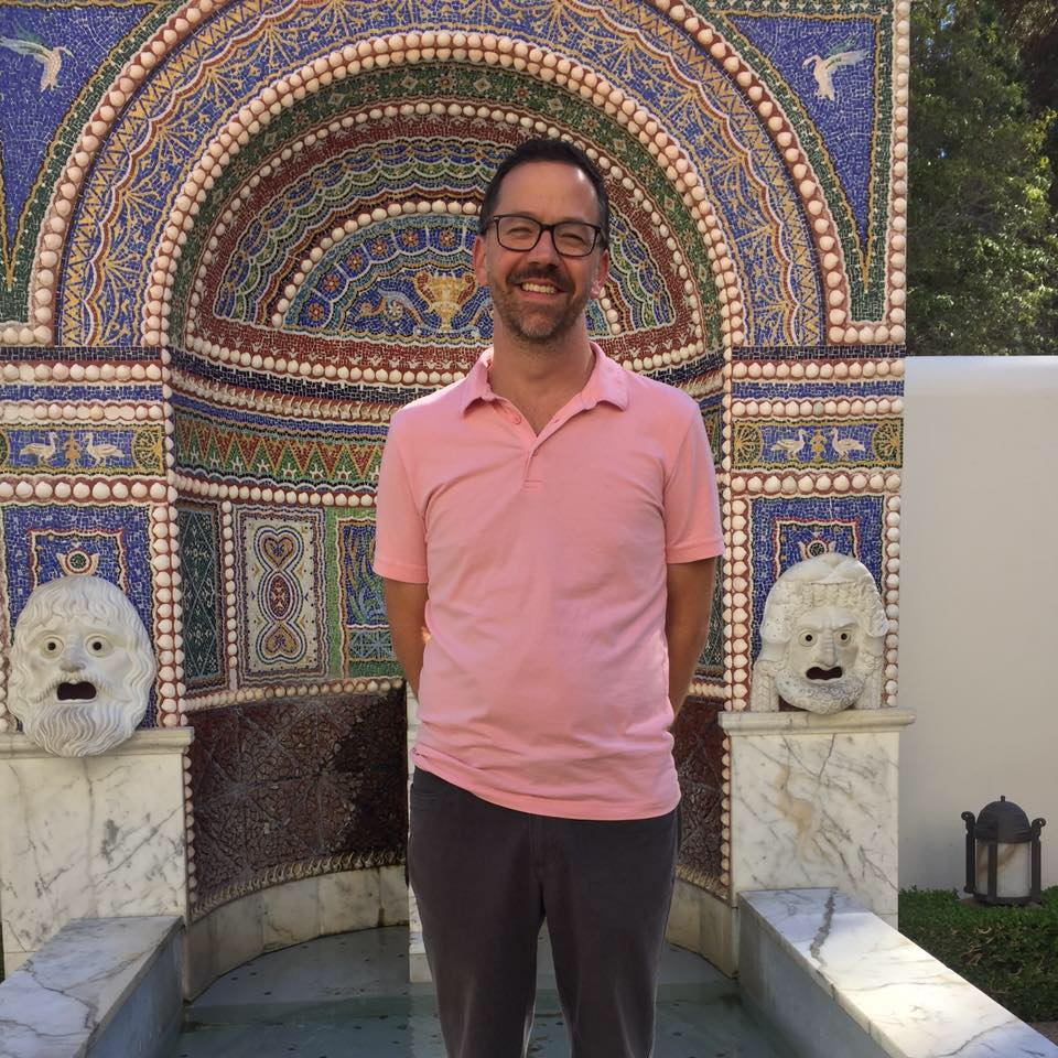 Eric Barber in front of a tiled fountatin