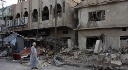 Calle de Bagdad en la que explotó un coche bomba en mayo 2014. Son las caricias de Dios todopoderoso | Ximinia