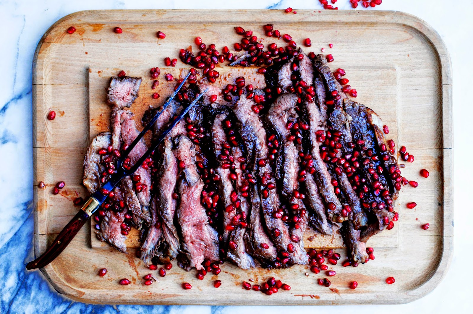 http://food52.com/recipes/31870-pomegranate-flank-steak