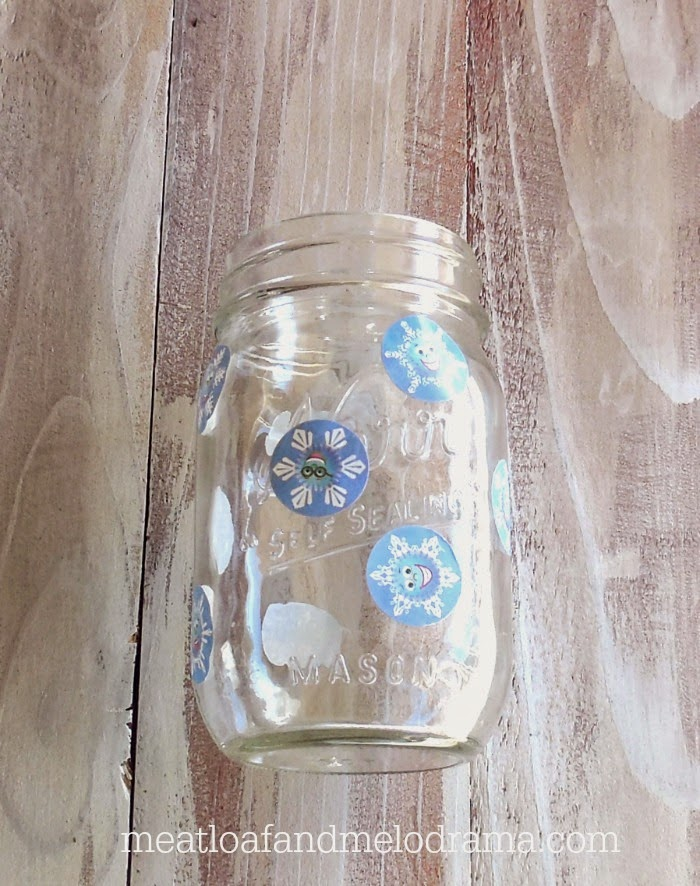 put round stickers on the outside of a mason jar