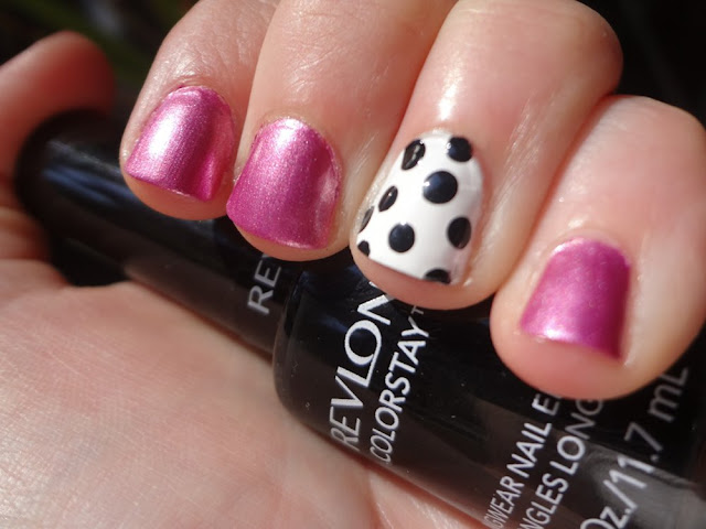 black and white polka dot accent nail with pink polish
