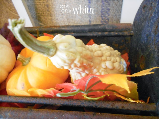 With a few leaves and gourds, this antique iron log roller looks great for fall! | Denise on a Whim