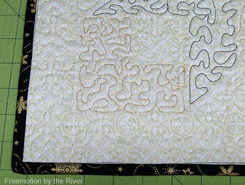machine sewing on the binding