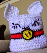http://www.ravelry.com/patterns/library/happy-kitty-toilet-paper-cozy
