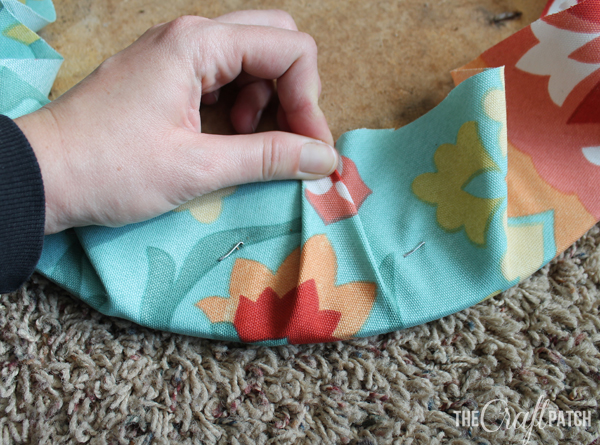 After you ve stapled a lot  you ll end up with bunches of fabric that stick  up  Pinch them into triangle shaped pleats like this The Craft Patch  How To Reupholster A Round Chair Seat. Recover A Round Chair Seat. Home Design Ideas