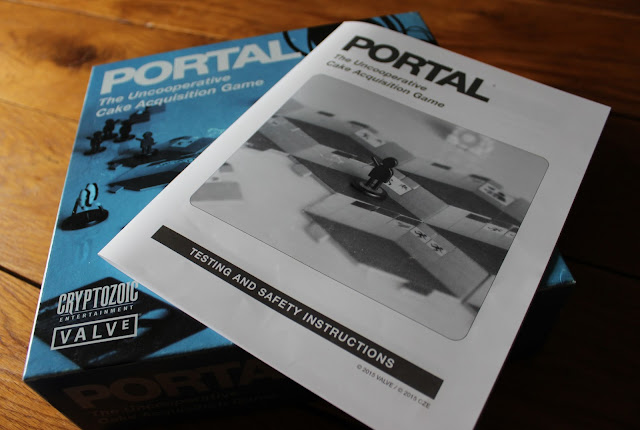Portal board game box and manual