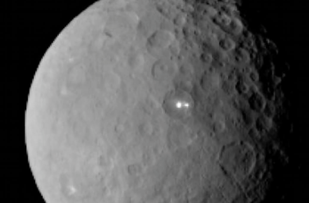 Dwarf Moon With Electric White Lights In Crater Found By NASA, Feb 19, 2015, Video, UFO Sighting News.