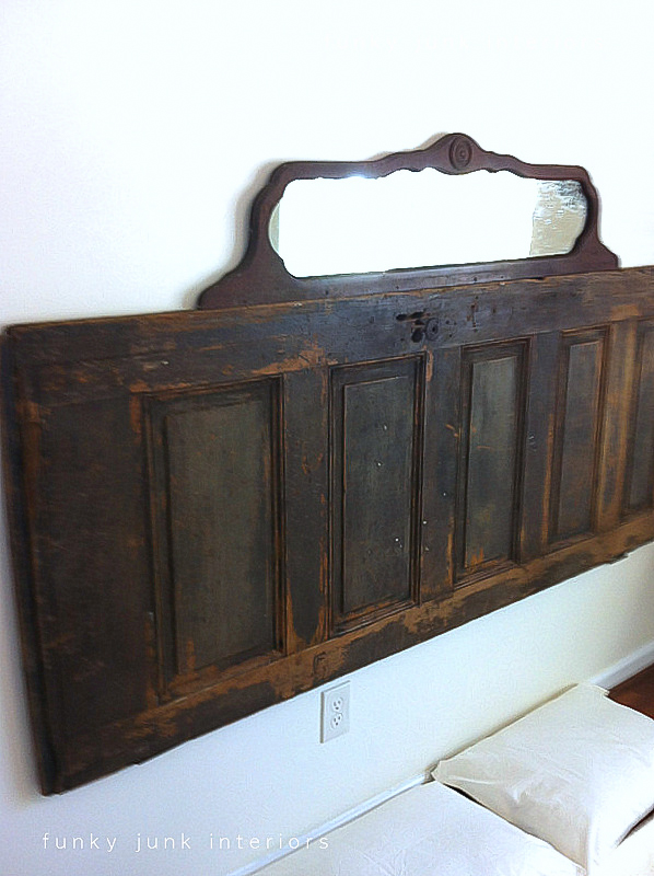 Old door and vintage mirror bedroom headboard via Funky Junk Interiors