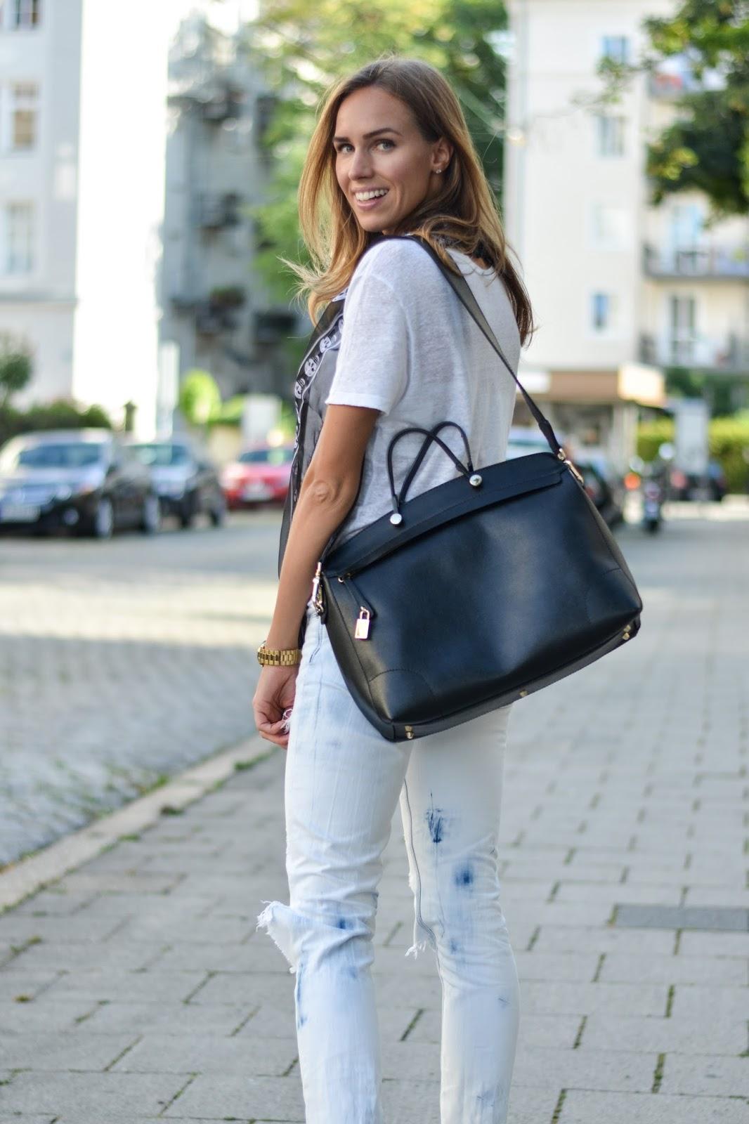 kristjaana mere black furla bag white tee white jeans outfit