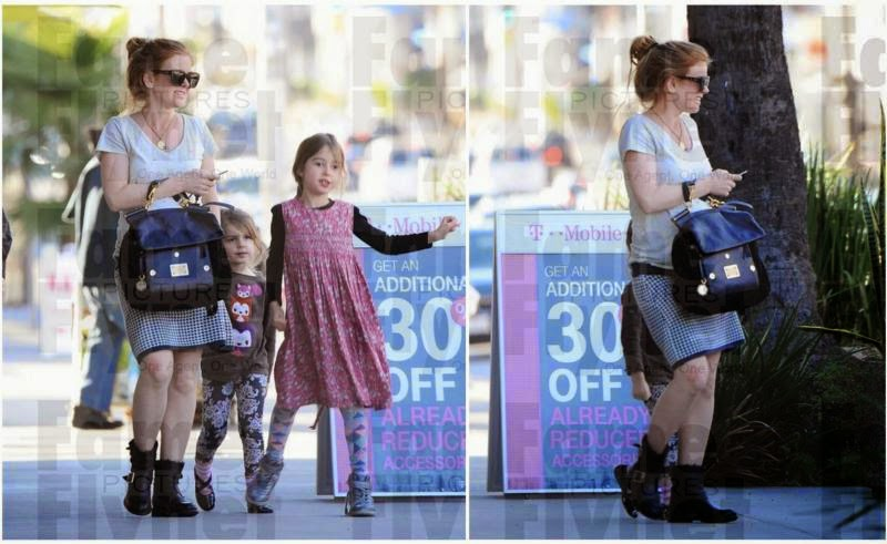 Isla Fisher showed off her baby bump