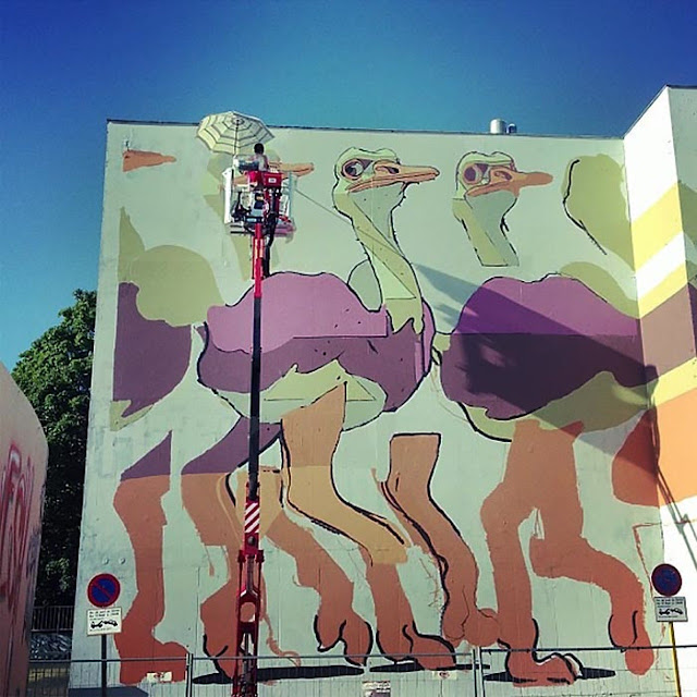 Spanish Street Artist Aryz at work on a new mural in Rennes For the Teenage kicks street art Festival.