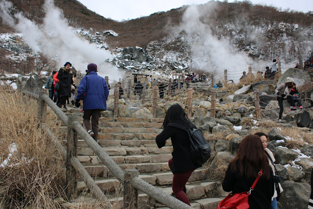 Getting closer to sulfurous fumes and hot spring pools at Owakudani Volcanic Hakone Valley in Japan
