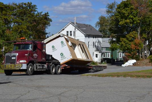 A witness to the incident said a second trailer carrying building materials  was detached and as the trailer carrying the home proceeded to move, ...