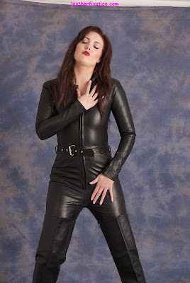 Sexy Brunette in Tight Leather Catsuit and Boots