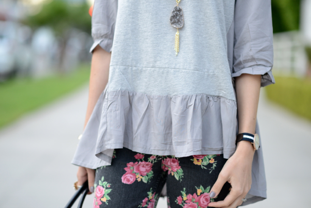 gray drapey top with floral jeans, M Loves M