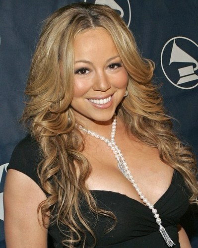 does the mariah carey e=mc2 deluxe edition come with the ipod skin inside the album?