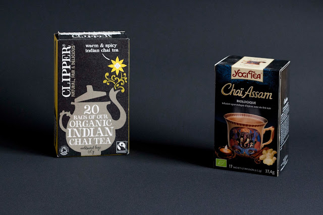 low key: tea boxes on a black background