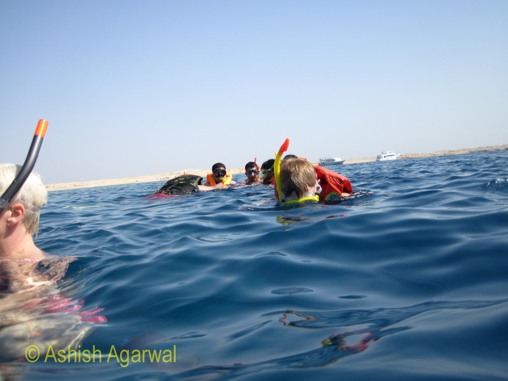 Faces of people snorkeling in the Red Sea in the Ras Muhammad national park in Egypt