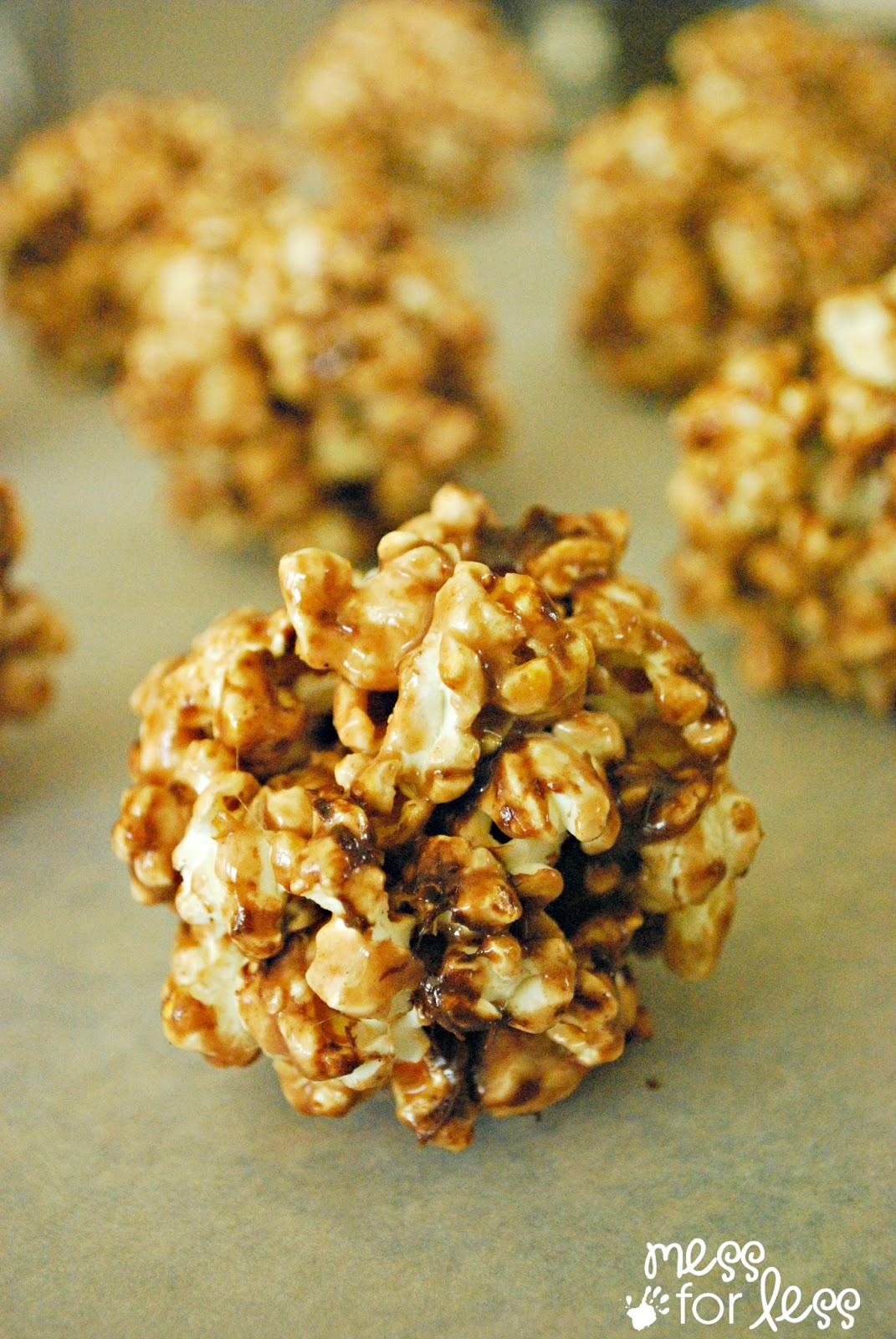These hot cocoa popcorn balls are the perfect holiday treat. #shop # ...