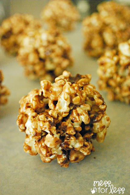 These hot cocoa popcorn balls are the perfect holiday treat. #shop #EasyGifts #Cbias