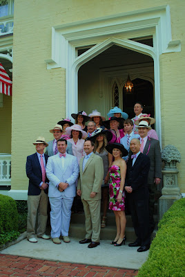 the men in our derby group standing on the front steps of the main house getting ready to leave and go to the track on oaks day
