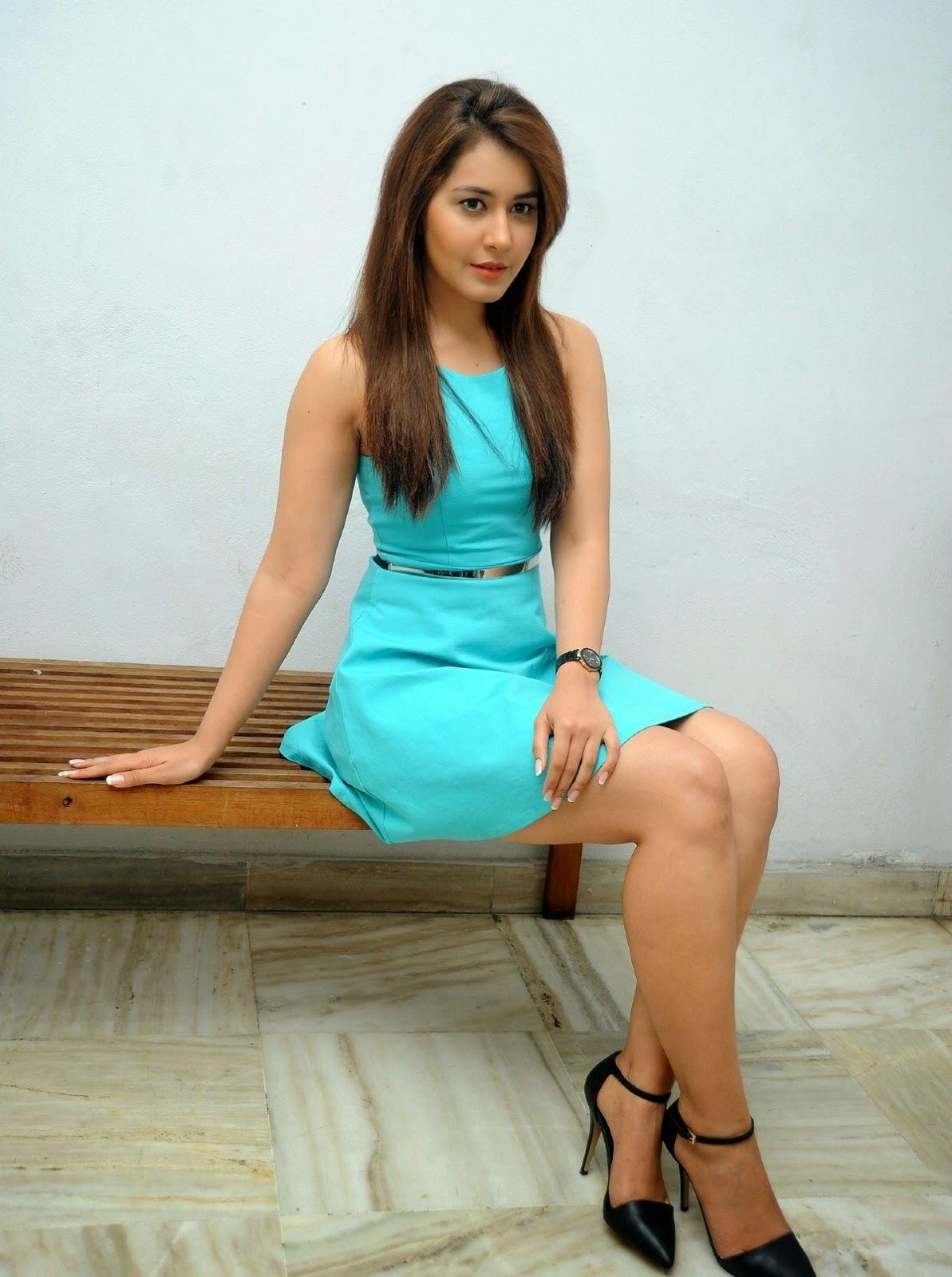 rashi khanna displays her silky smooth sexy legs in a blue short dress