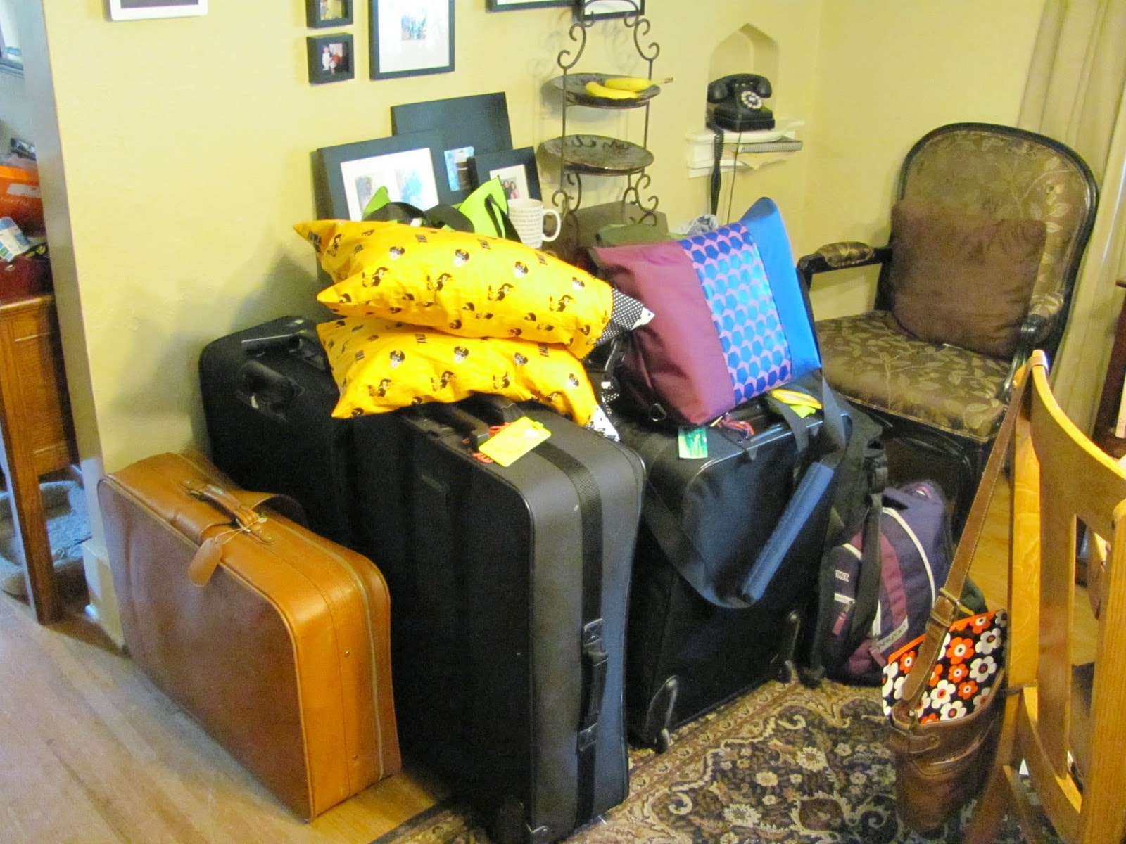 A large pile of suitcases, backpacks, and bags ready to be loaded into the car going to the airport
