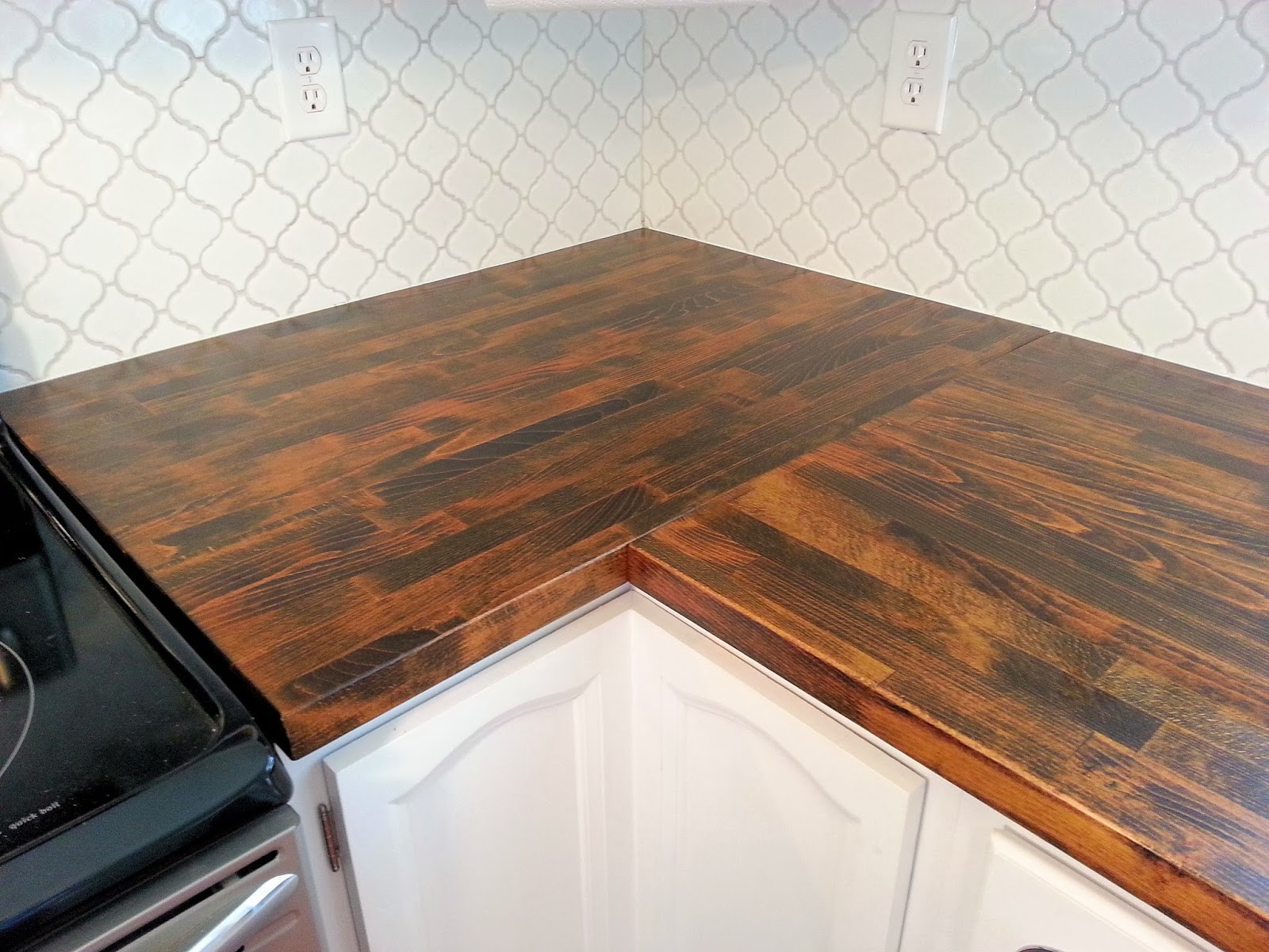 Stained Ikea Butcher Block Countertop and Moroccan Tile Backsplash