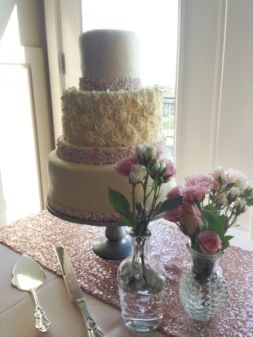 4-tier round fondant, beads, and buttercream