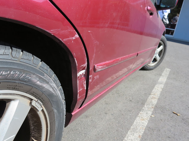 Dented door & quarter panel before repairs at Almost Everything Auto Body