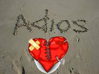 corazón herido dibujado en la arena