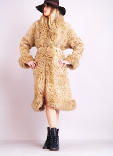 Vintage 1970's tan colored bohemian style shearling maxi coat with mongolian fur trim.
