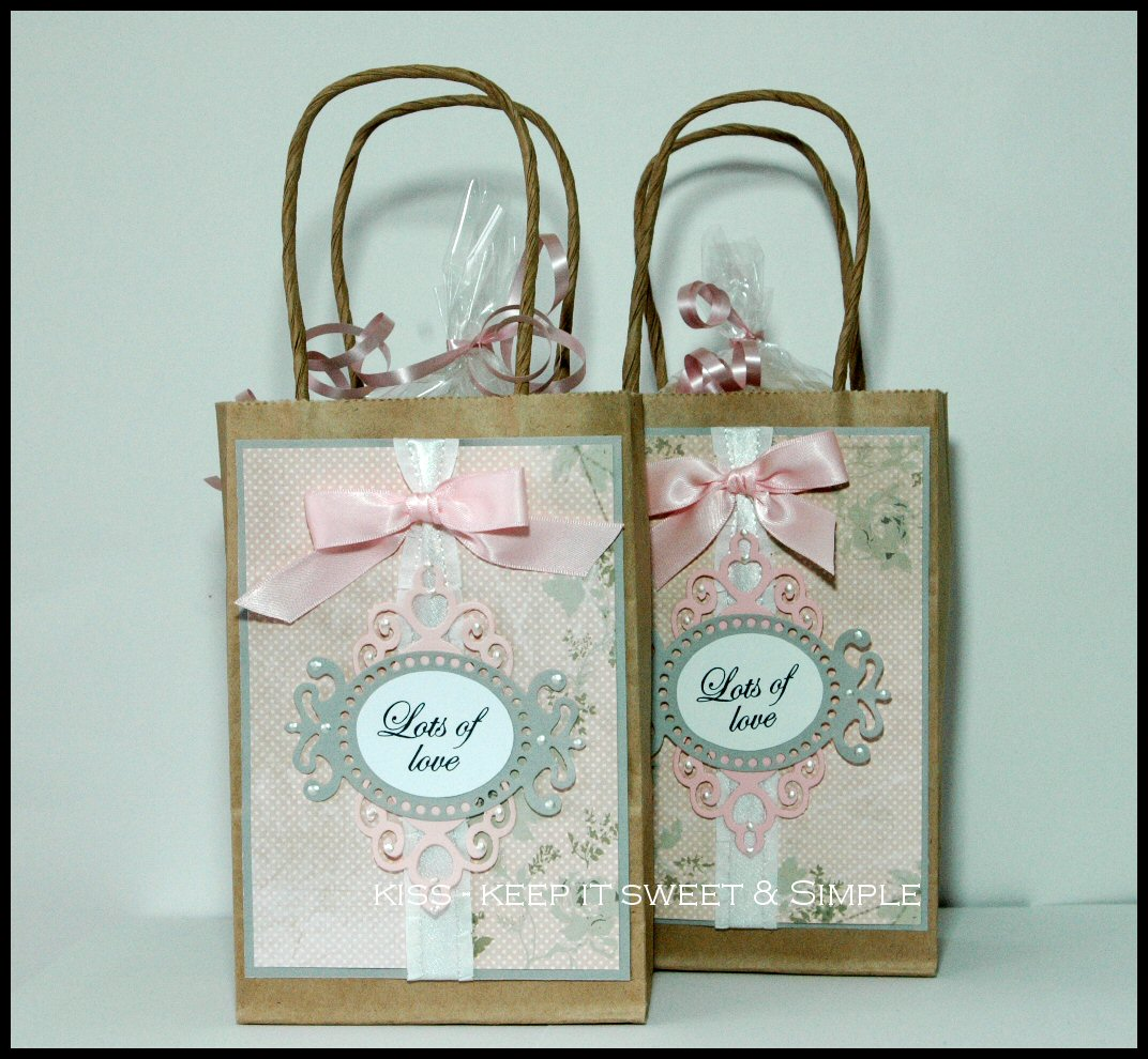 Kiss keep it sweet and simple all you need is love i decorated a couple of small brown paper gift bags with my dp and then added a pink bow to my white ruffled ribbon strip i would rather have used all negle Gallery