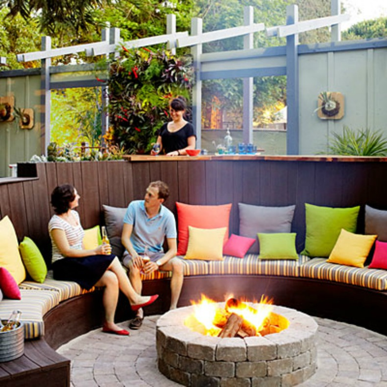 Coastal seating around fire pit in outdoor lounge space