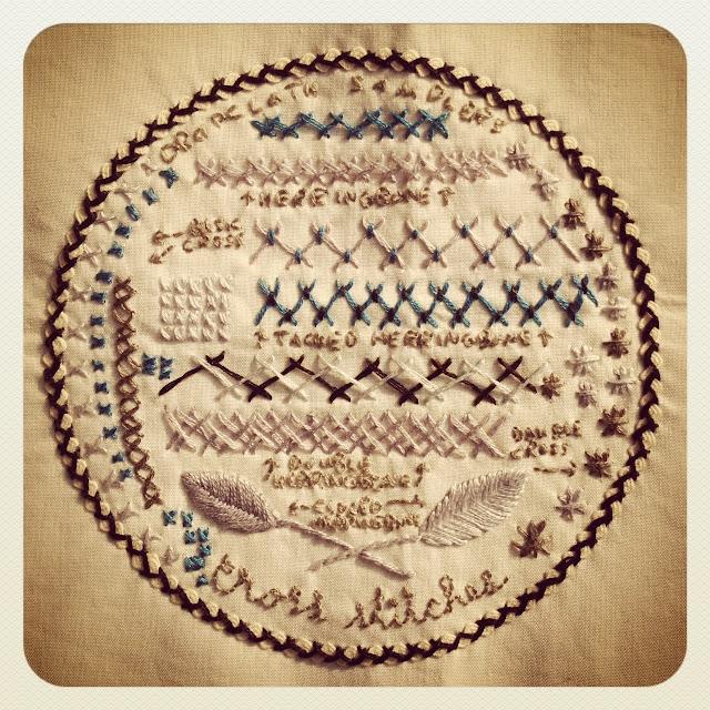 Drop cloth cross stitch sampler